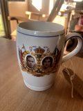 Rare George VI coronation mug featuring Princess Elizabeth.